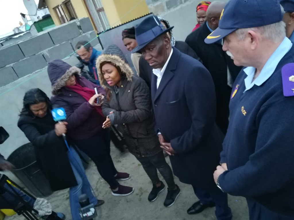 Police Minister Bheki Cele visits the family of murdered policeman Constable Songezo Khetiwe. (Supplied)