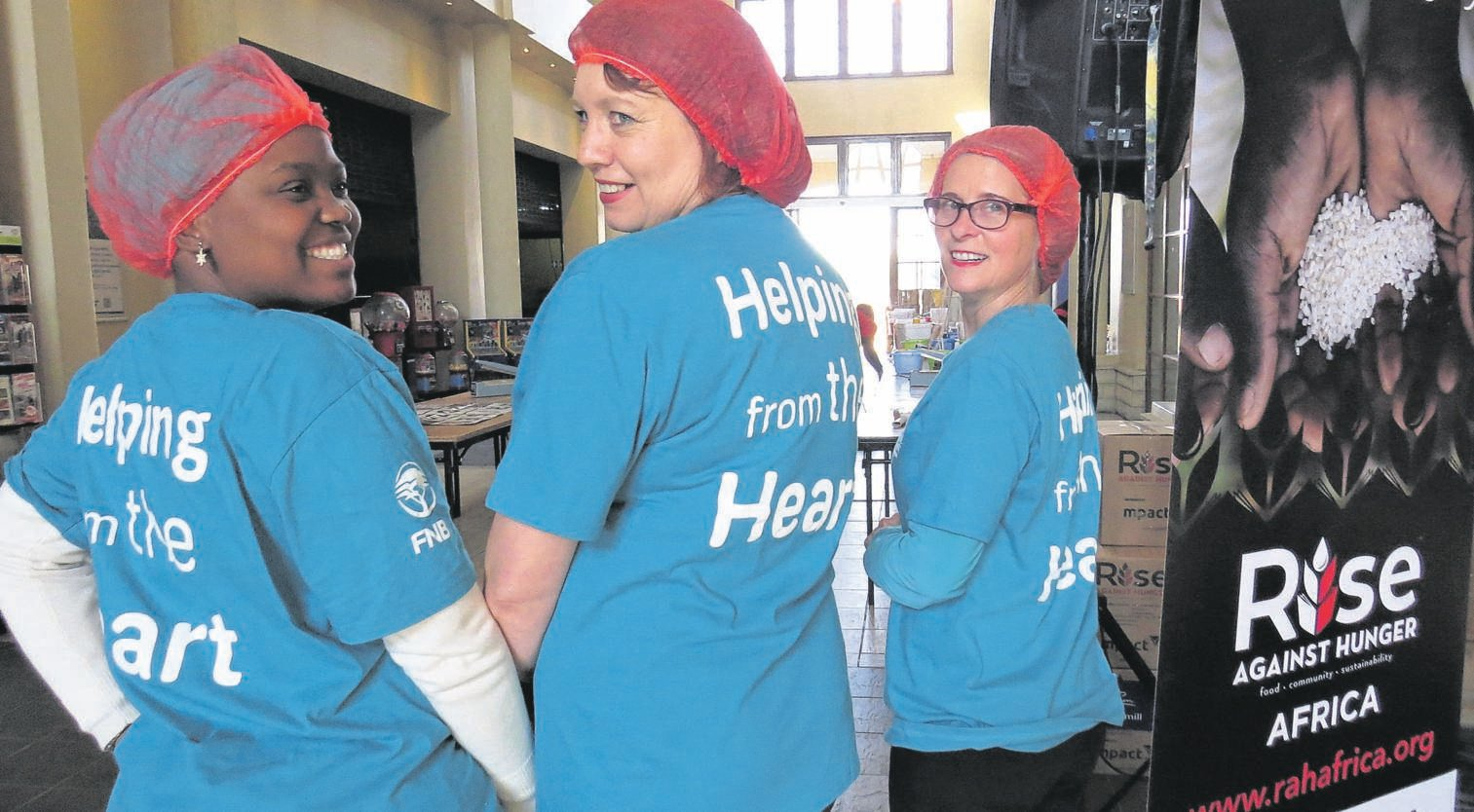 Volunteers of FNB gave up 67 minutes of their time to participate in the Rise Against Hunger initiative on Mandela Day. From the left are Nosipho Mpiti, Marna Meyer and Selente Stander.