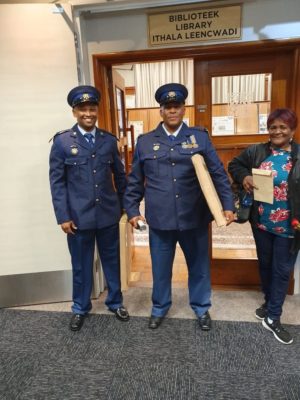 Constable Emile Farao, Warrant Officer Michael Daniels and Jane Daniels. (Supplied)