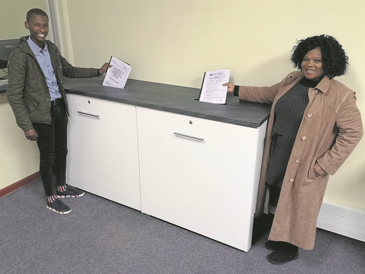 Kouga Municipality is doing away with its old tender box. A new tender box had been installed at the municipality's Supply-Chain Management offices. Lolwethu Desha and Khanyiswa Vumazonke at the new tender box in Woltemade Street.                                                    Photo:SUPPLIED