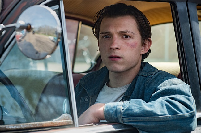Tom Holland as Arvin Russell.