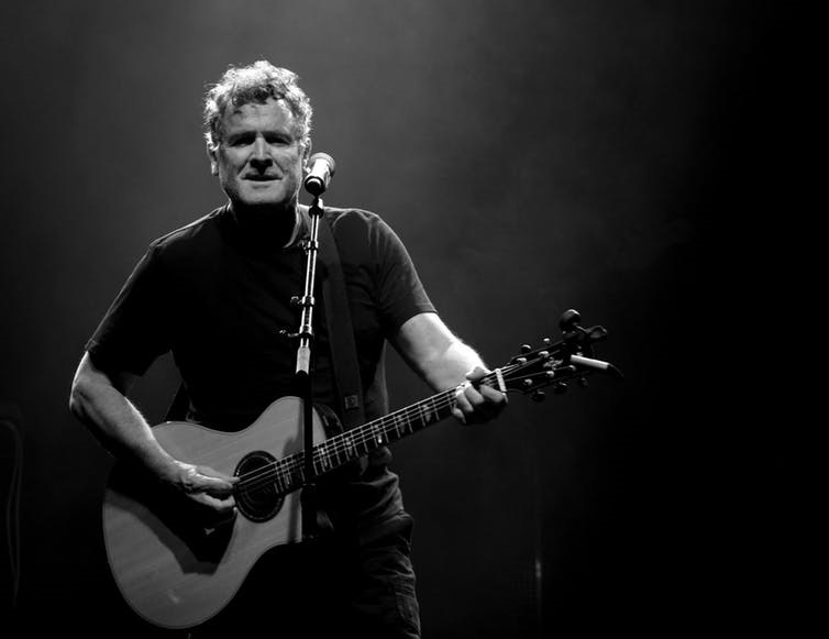 Johnny Clegg in action, telling stories and making music. (Dominique Cardinal/Flickr, CC BY-NC-ND)