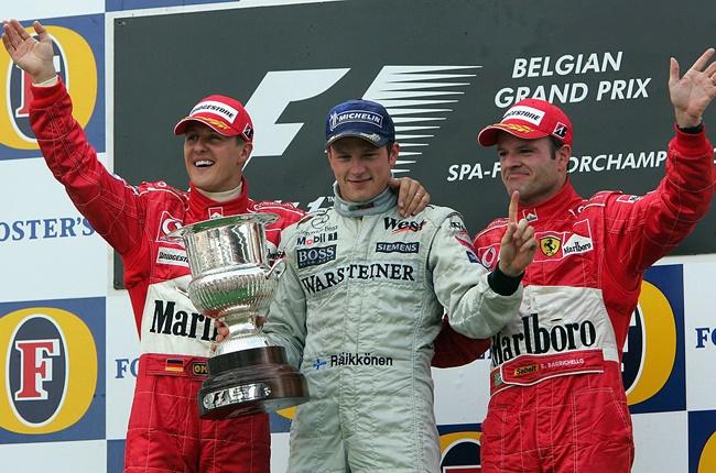 Kimi Raikkonen taking victory at the 2004 Belgian Grand Prix ahead of Michael Schumacher (left) and Rubens Barrichello (Mark Thompson / Getty Images)