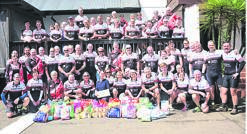The Burg Wheelers Cycling Club after their annual road and mountain bike rides in support of the SPCA recently. A large amount of cat food plus around R2 000 was raised by the club to support the SPCA, who were on hand to receive the donations. PHOTO: supplied