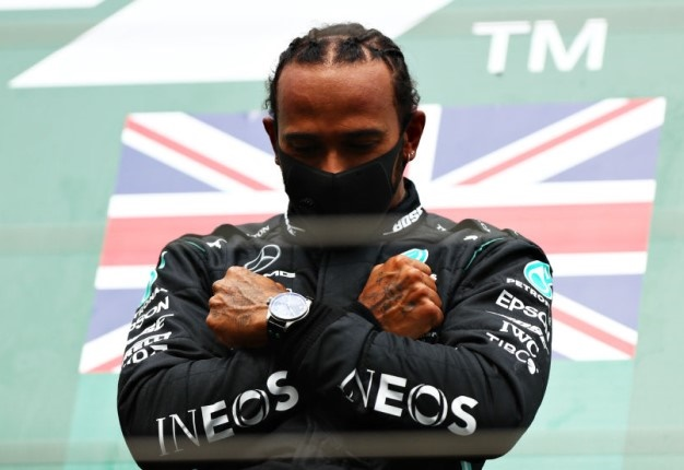 Race winner Lewis Hamilton celebrates on the podium with a tribute to the late Chadwick Boseman during the F1 Grand Prix of Belgium at Circuit de Spa-Francorchamps . Image: Dan Istitene / Getty