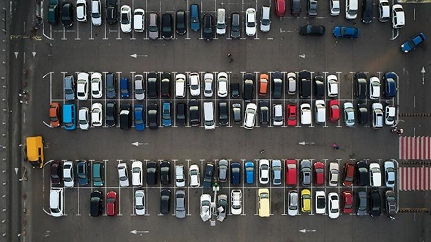Car parking lot viewed from above, Aerial view. To