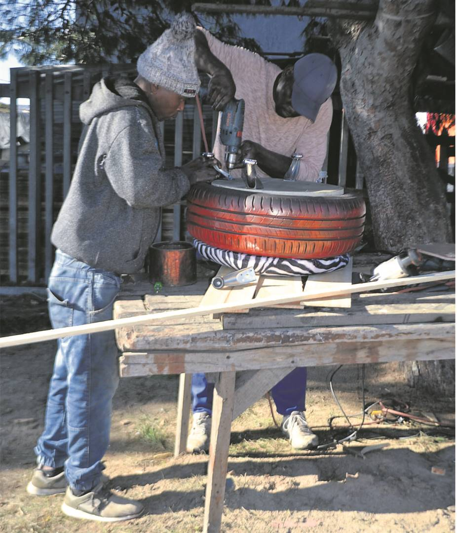 Blessed Nhekede and Fungai Duri are making a tire seat.PHOTOS: UNATHI OBOSE