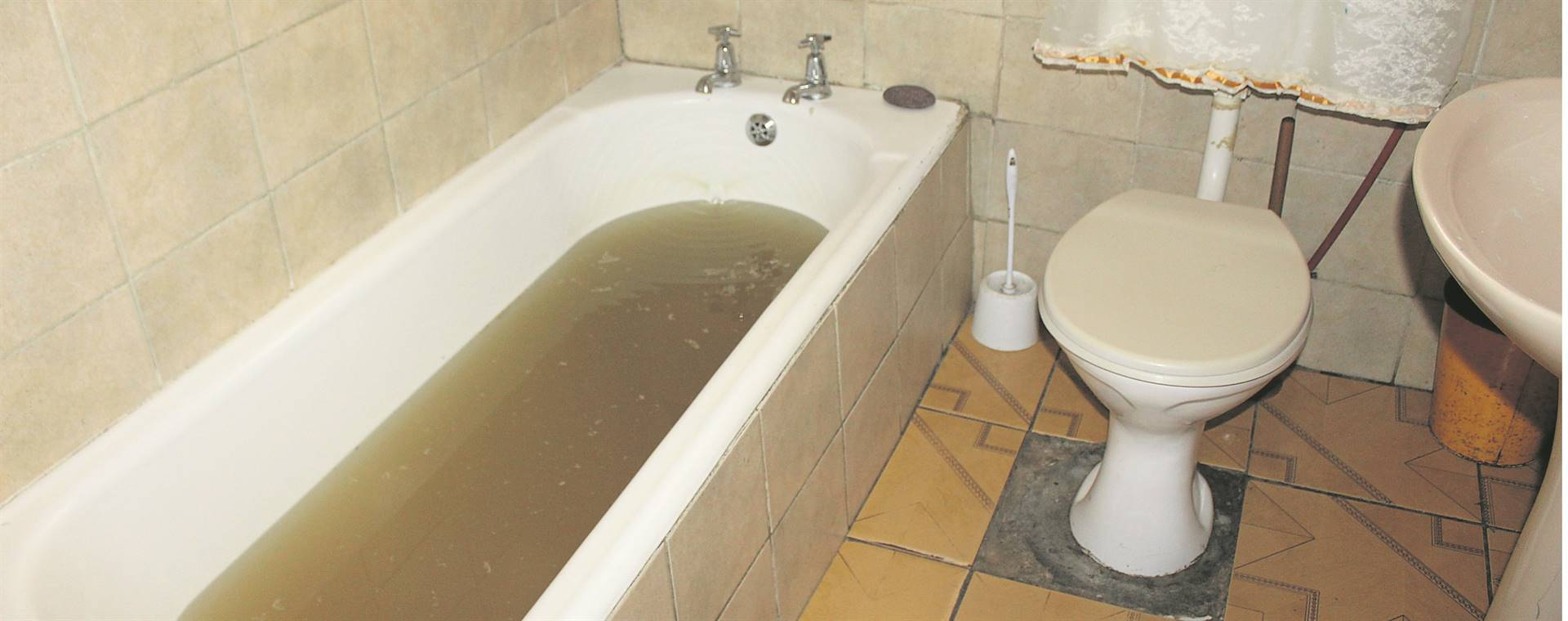 Sewage comes up from the bathtub in this home in Nomzamo. PHOTOS: Velani Ludidi