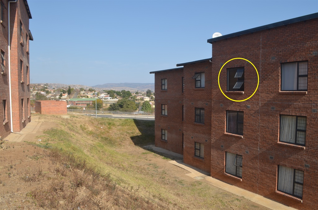 A four-year-old boy was seriously injured when he fell head first from the third floor at the Aloe Ridge flats in Westgate on Tuesday afternoon. Circled is the window from which the boy fell.