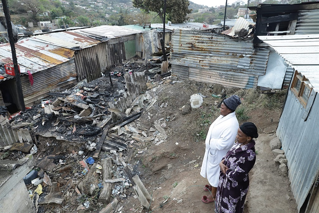Residents of Clermont in KZN survey the damage caused by a deadly dire that claimed three lives.