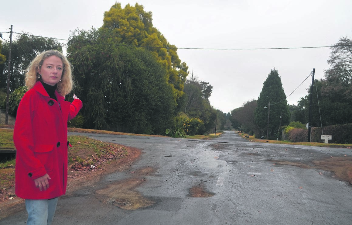 Howick councillor Janis Holmes stands at the corner of Buchanan and Fraser streets, where road markings have faded away.