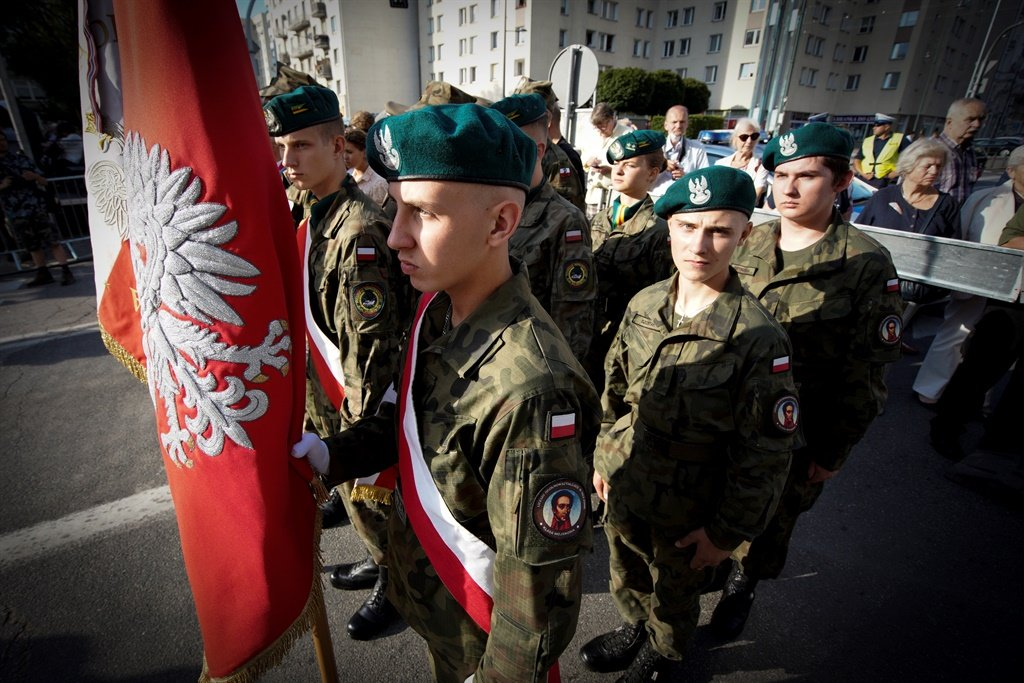 Youths from a military school take part in a ceremony in Warsaw before the re-enactement of the WWII Nordwache battle that took place on August 3, 1944 in the Wola district of Warsaw. (Jaap Ariens, AFP)