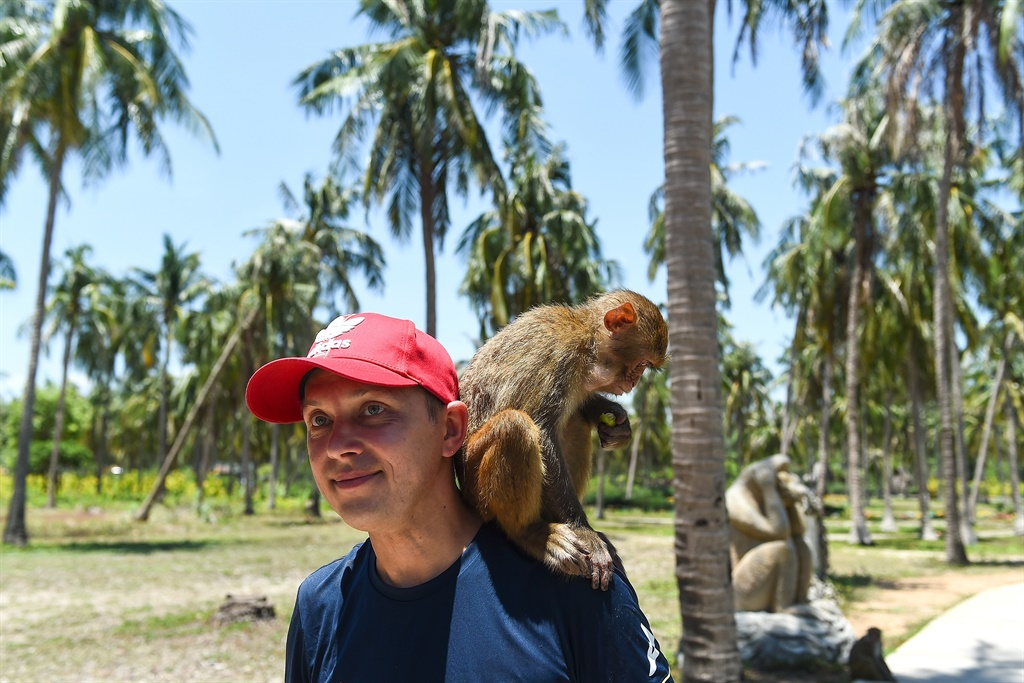 A tourist posing with monkeys at Monkey Island in Nha Trang, central Vietnam. (Nhac NGuyen, AFP)