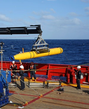 The Bluefin 21, Artemis autonomous underwater vehicle (AUV) is hoisted back on board the Australian Defense Vessel Ocean Shield after successful buoyancy testing in the Indian Ocean. (File, AP)