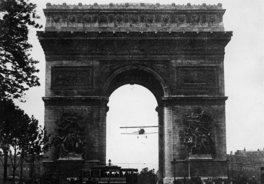 This photograph taken on August 7, 1919 shows French aviator Charles Godefroy flying through the Arc de Triomphe in Paris with his Nieuport 27 aeroplane. (AFP)
