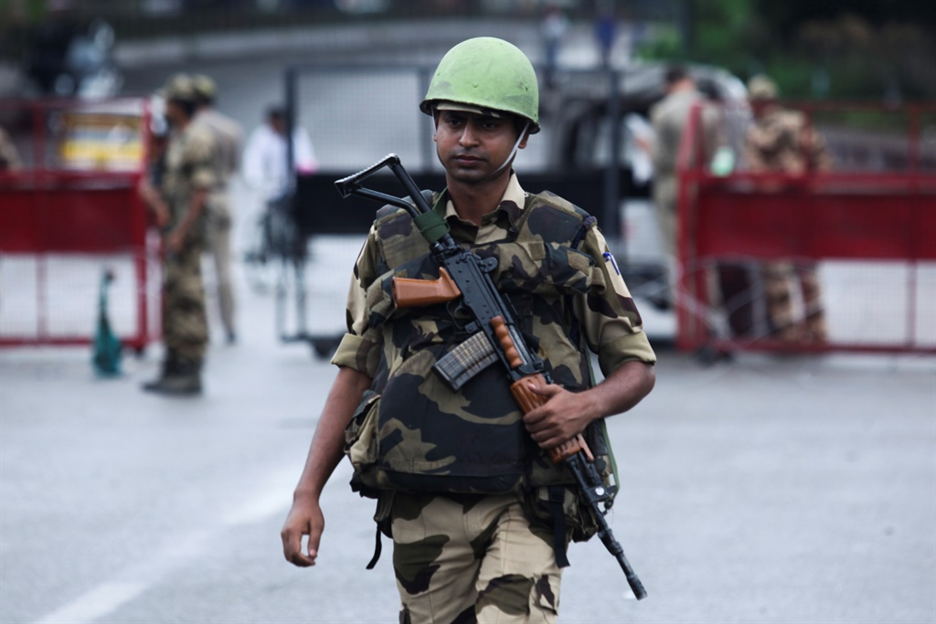 A security personnel stands guard at a roadblock in Jammu. (Rakesh Bakshi, AFP)