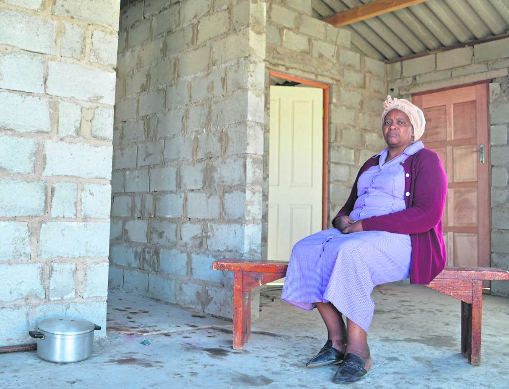 Neliswa Antonie sitting in her newly rebuilt home after a fire destroyed all that she had. The St Thomas Presbyterian Church rebuilt the house within two weeks after the fire.                                               Photo:HEILIE COMBRINCK