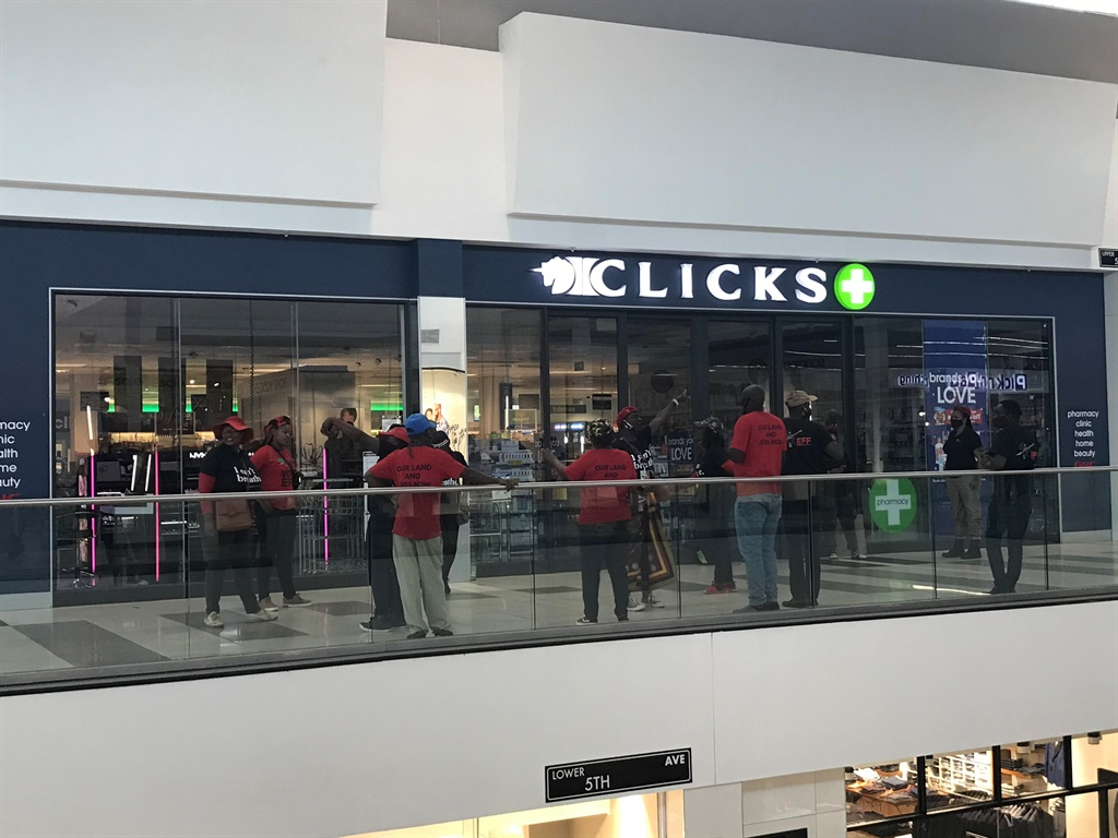 EFF members protesting outside of a Clicks store i