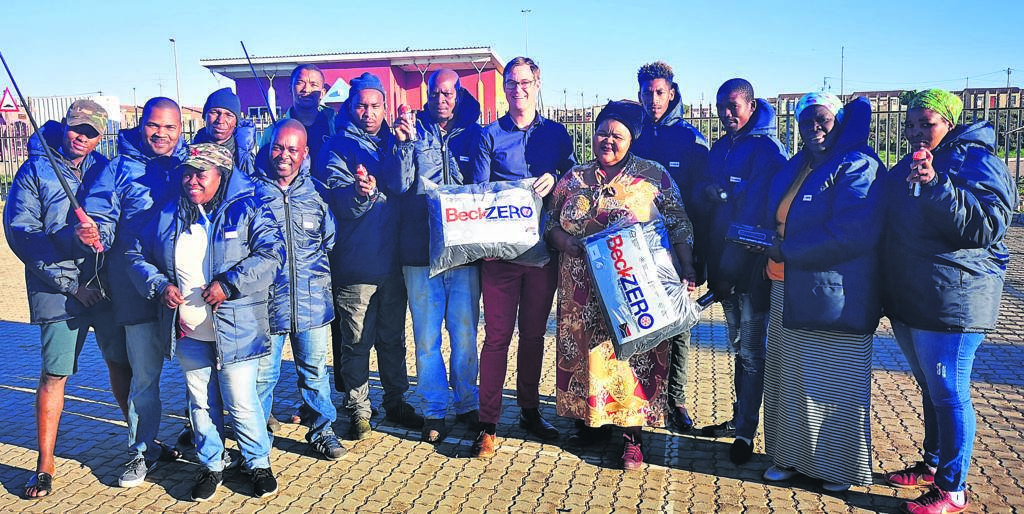 Ocean View CPF members try on their new jackets, purchased through the Ward Development Fund and delivered this week by Kouga Speaker Hattingh Bornman (6th right) and Ward 14 Councillor Sindiswa Makhasi (5th right).                            Photo:SUPPLIED