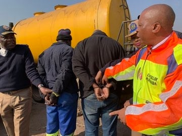 Johannesburg Mayor Herman Mashaba at the scene where 10 people suspected of stealing diesel directly from buses at the Wemmer Metrobus depot were arrested. (Supplied)