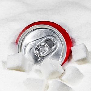 Soft drinks can sitting in sugar like an iceberg,