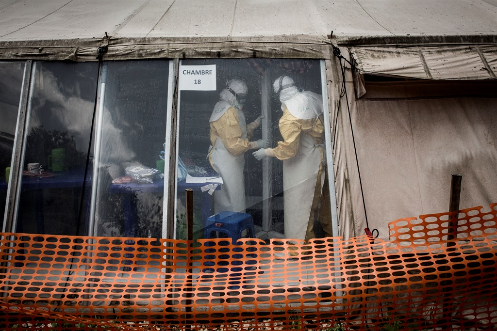 Health workers are seen inside the 'red zone' of an Ebola treatment centre. (John Wessels, AFP)