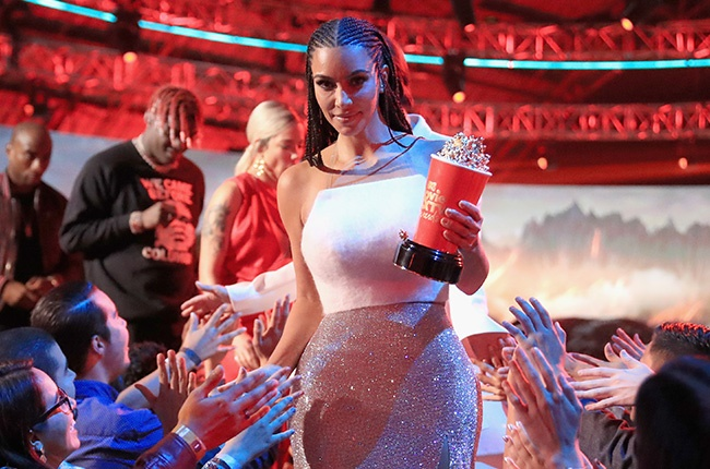 Kim Kardashian, winner of the Best Reality Series/Franchise award for 'Keeping Up with the Kardashians', walks off stage during the 2018 MTV Movie And TV Awards at Barker Hangar on 16 June 2018 in Santa Monica, California.