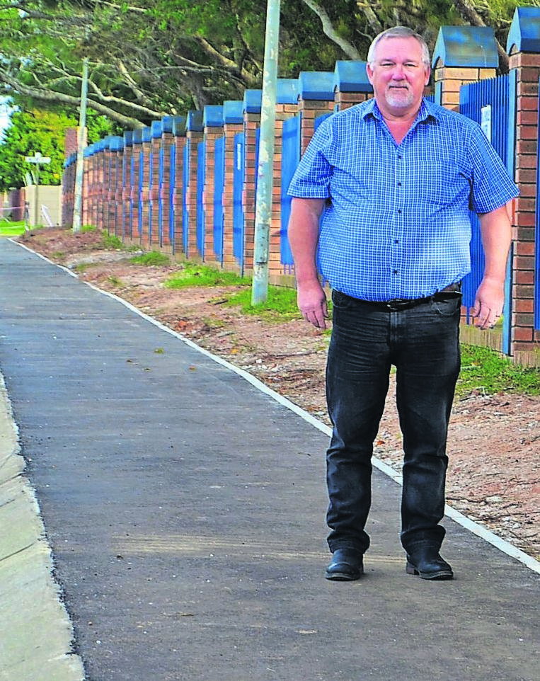 Councillor Gustav Rautenbach on one of the new sidewalks, next to Lorraine Primary.     photo:KAILIN DANIELS