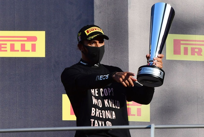 Race winner Lewis Hamilton of  Mercedes GP celebrates on the podium during the F1 Grand Prix of Tuscany at Mugello Circuit on September 13, 2020 in Scarperia, Italy. (Photo by Jenifer Lorenzini - Pool/Getty Images)