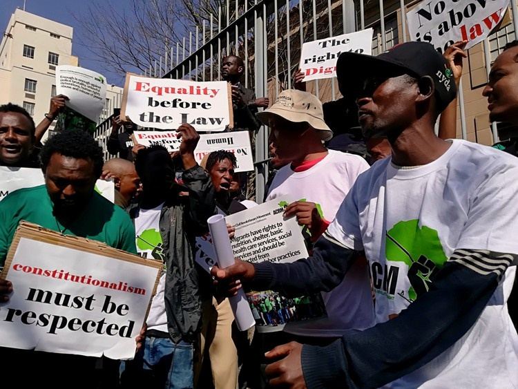 On Monday about 60 people picketed outside the Johannesburg Magistrate's Court in support of immigrants arrested during police raids last week. (Zoë Postman, GroundUp)