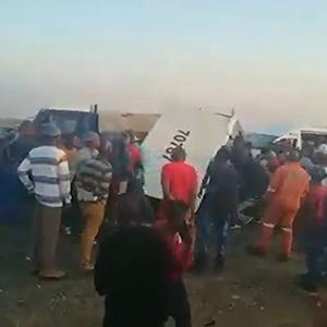 Vlaklaagte residents loot the cash van after the heist. (Screengrab)