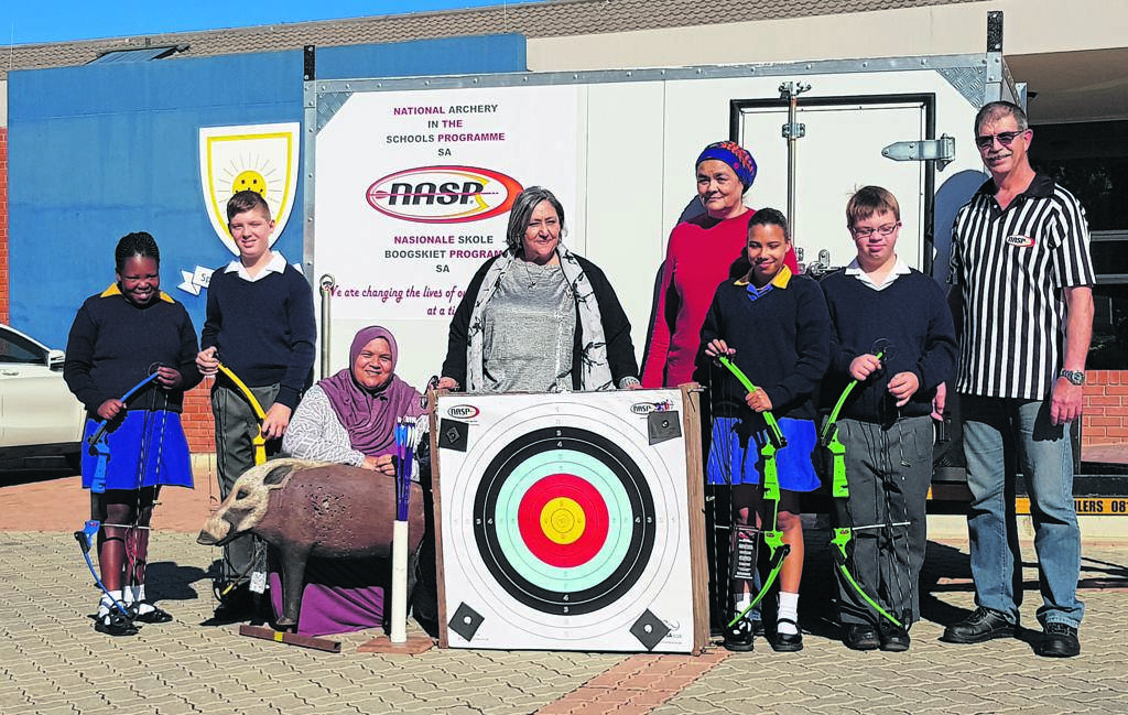Teachers and students from Sunshine Special School recently received archery equipment from NASP. From left are Lisakhanya Williams, Nathan Mitchell, educator Shereen Reciet, principal Candace Kivedo, educator Aneekon Abrahams, Georgia Landoe, Benjamin Jonck and Chris Oelofse from the National Archery in Schools Programme.                      Photo:SUPPLIED