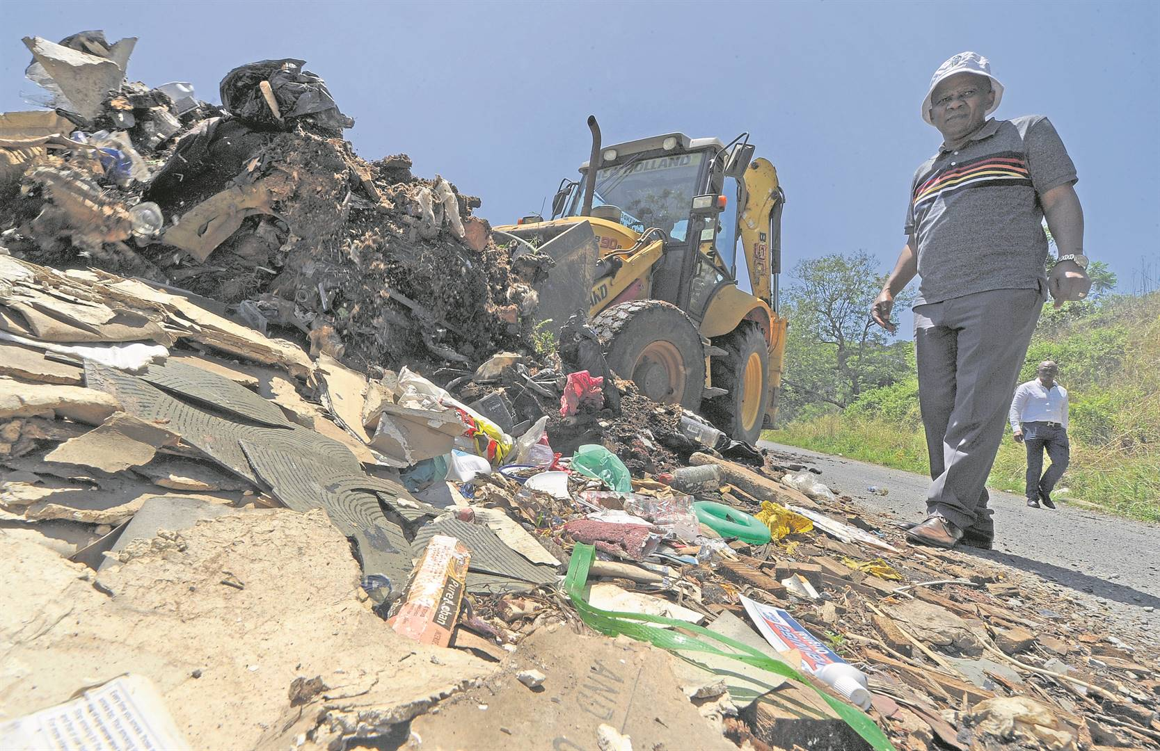 Outgoing mayor Themba Njilo supervises cleaning work on Dr Chota Motala road. PHOTOS: Ian Carbutt (File)