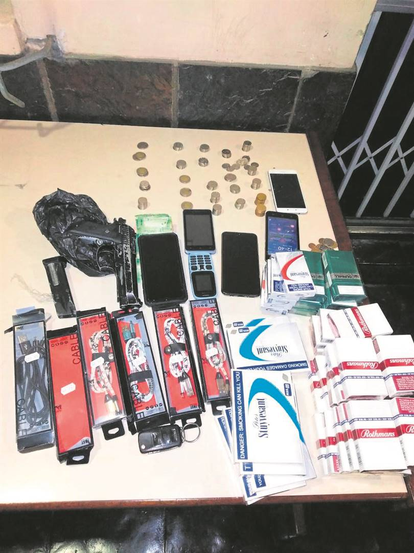 Stolen items and a toy gun recovered by Harare police on Sunday.PHOTO: