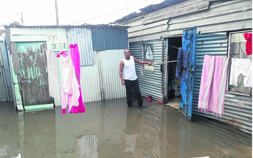 Zilindile Ngcanasa is standing in front of his flooded shack.PHOTOS: UNATHI OBOSE