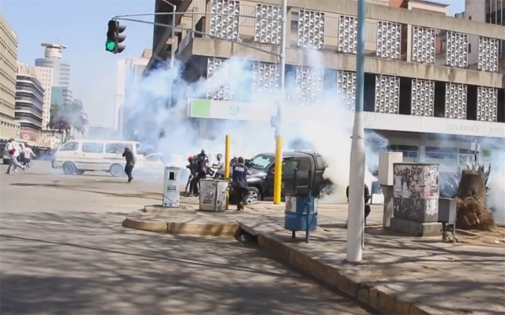 Zimbabwe police fire teargas at protesters in Harare on August 16.