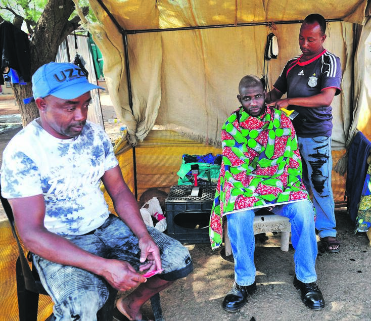 Rama Mute's barber shop has to service clients on debt. Picture: Rosetta Msimango