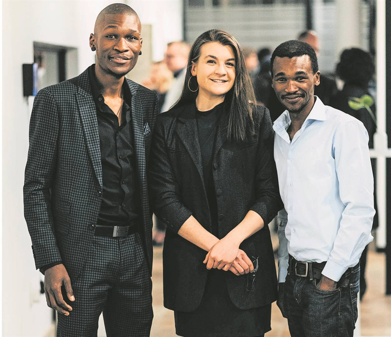The New Breed winners' exhibition can be viewed by the public until Friday (23/08) at the law firm Phatshoane Henney's premises at 35 Markgraaff Street. Present at the launch are from the left the artists Xola Sello, Petra Schutte and Nkululeko Nkebe.Photo: Supplied