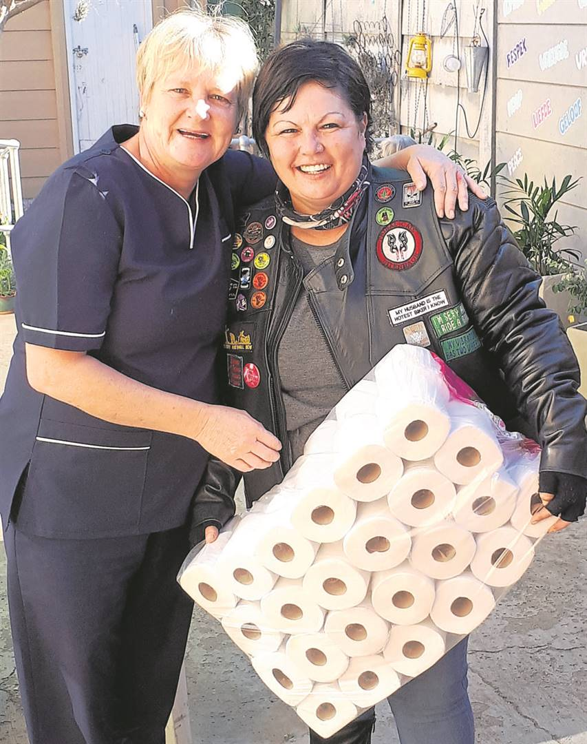 Dawn Grobler (left) owner of Plekkie ini Son old age home was very thankful for goods Jo-Anne Williams, secretary for the motorcycle Trible Cats Club in Uitenhagetogether with otherbiker clubs donated to them.                    Photo: Supplied