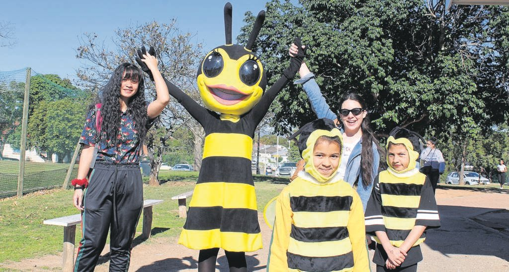 IT was a hive of activity at Riebeek College Girls' High School's Family Fun Festival. Here are Natheerah Sataar, Tamia Smith (in the bee mascot outfit), Casey Els, Gizelle Dennis (small bee in front) and Thaaniya Shungking (small bee at the back). A bee is the symbol of the school and appears on its emblem.                               Photos:SUPPLIED
