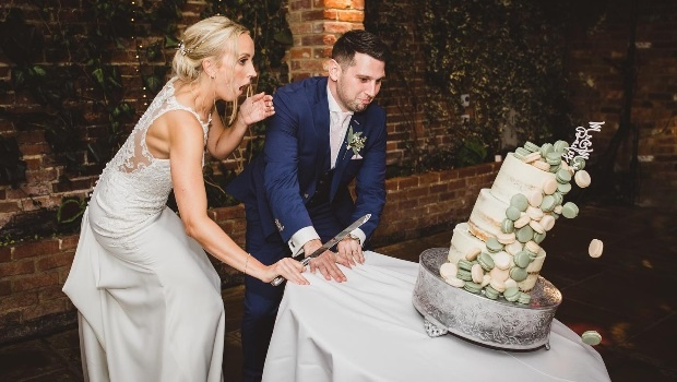 Oops! Wedding photographer captures blow-by-blow images as newlyweds look on horrified as R8 000 wedding cake topples to the floor