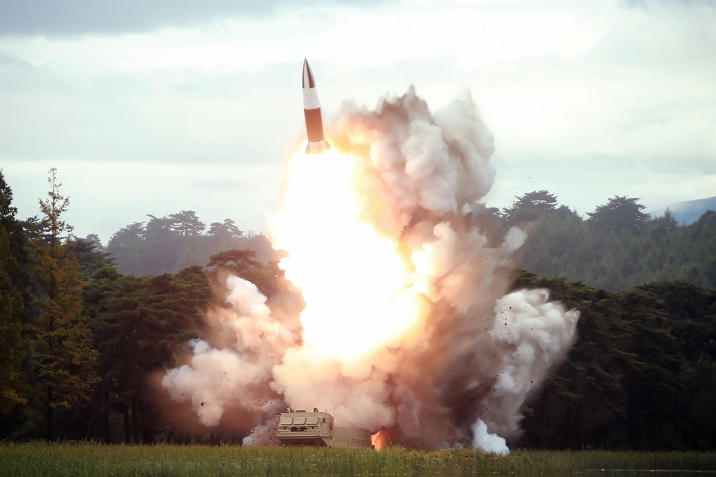The test-firing of a new weapon, presumed to be a short-range ballistic missile, at an undisclosed location. (KCNA via KNS, AFP)
