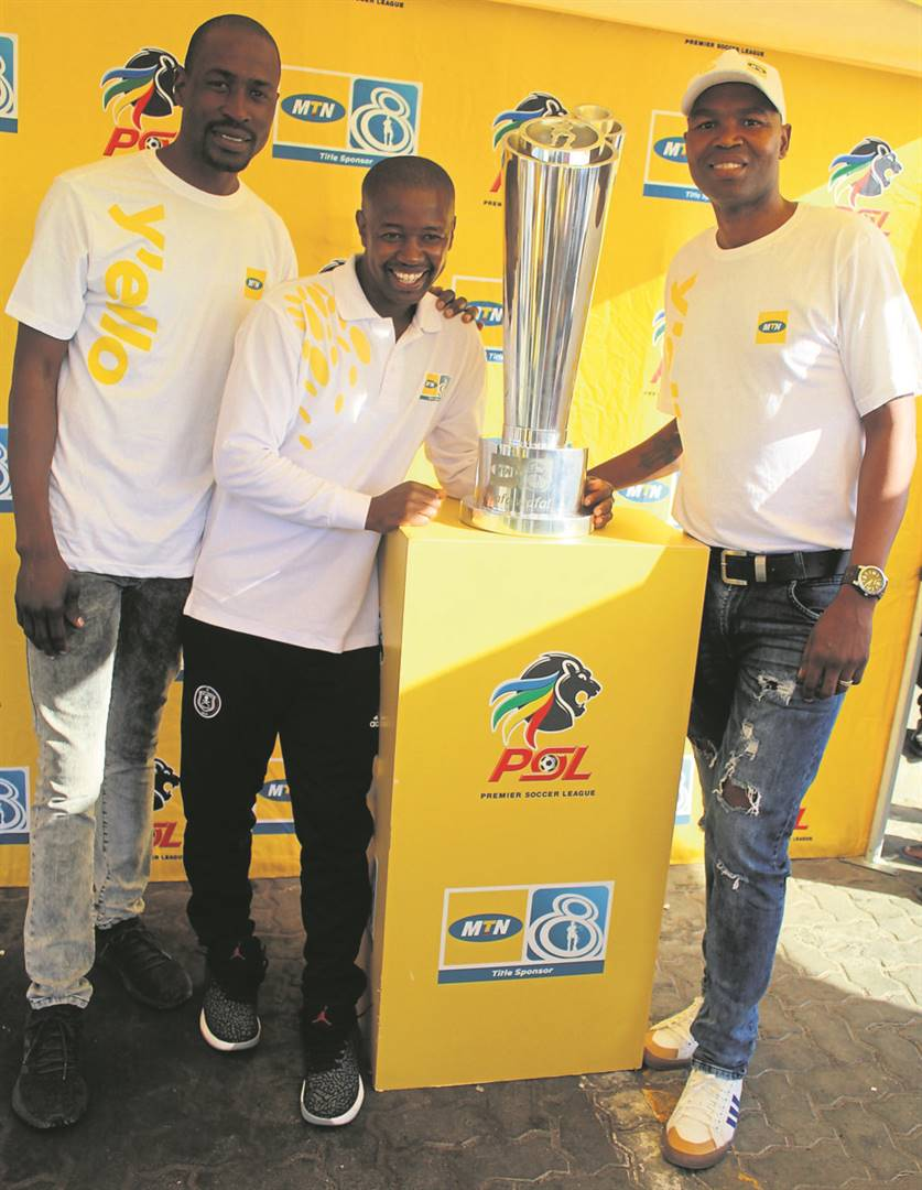Soccer legends Benson Mhlongo, Joseph Makhanya and Patrick Mayo showing the MTN 8 Trophy at Zonke Superspar.Photo:SELBY MADIKANE