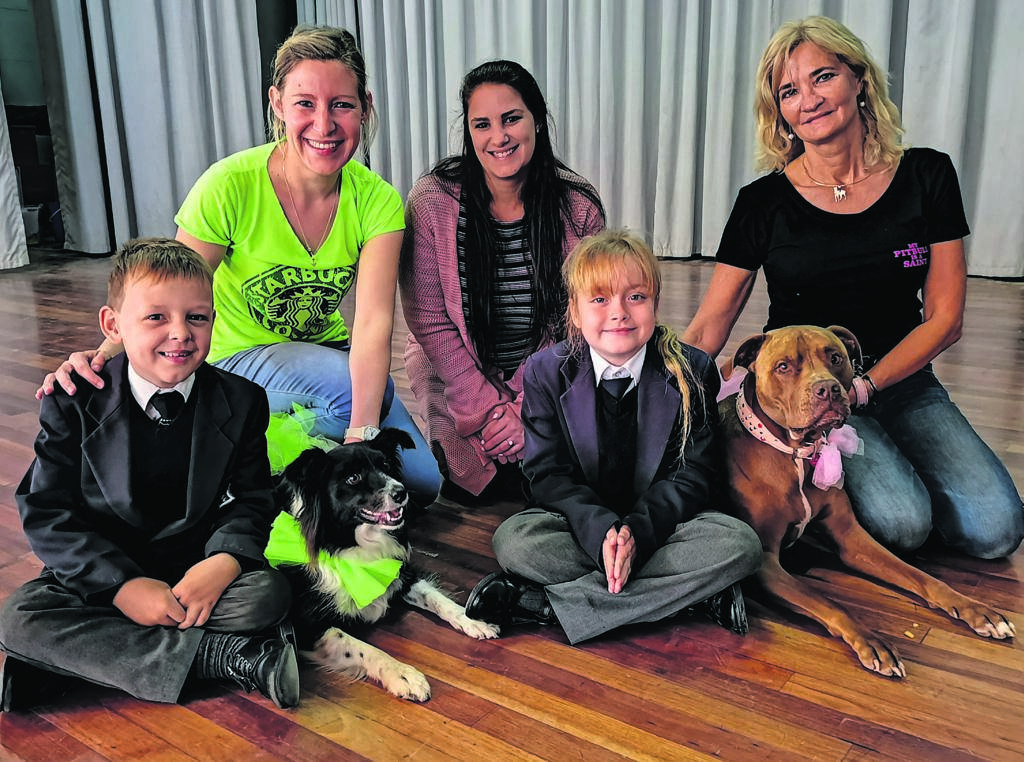 Kabega Primary School hosted a dog show by Paws-Up on Friday, August 16, where they raised money and collected food donations for domestic animal care. At the back are Talita van Eeden, Bernice Steynberg and Marizanne Ferreira. In front are Barend Grobler, Pepsi, Shane Ferreira and Yanka. Photo:SUPPLIED