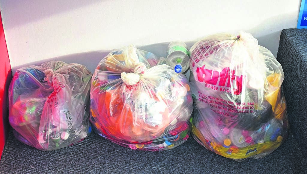 Bags of plastics collected at Angels Training and Resource Centre. Proceeds are donated to Operation Smile.