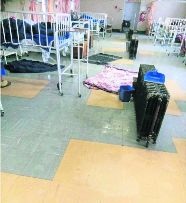 A photo shows the soaked floor in the maternity ward at the National Hospital apparently due to negligence by someone who left taps open.Photo: Supplied