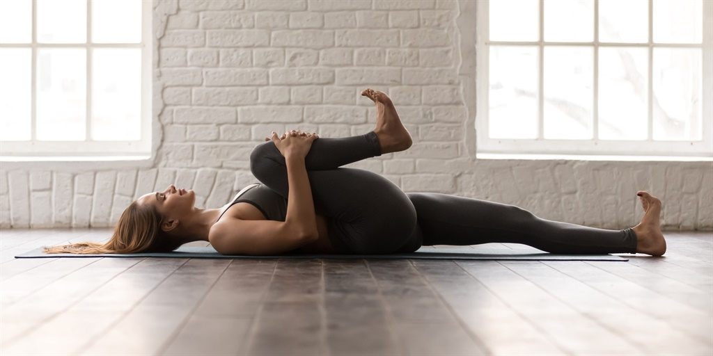 Calm woman with closed eyes practicing yoga, attra