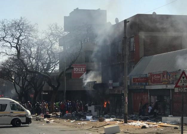 Shops are burnt and looted in the Pretoria CBD.