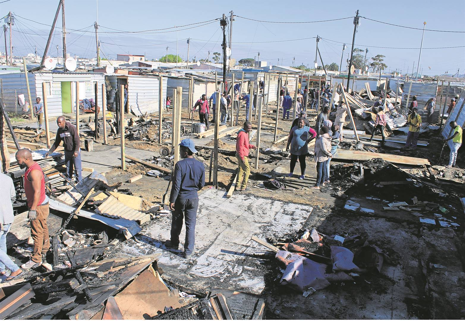 Victims try to rebuild their lives and homes after a fatal fire ripped through Ezinkomeni informal settlement on Saturday.PHOTO: MZWANELE MKALIPI