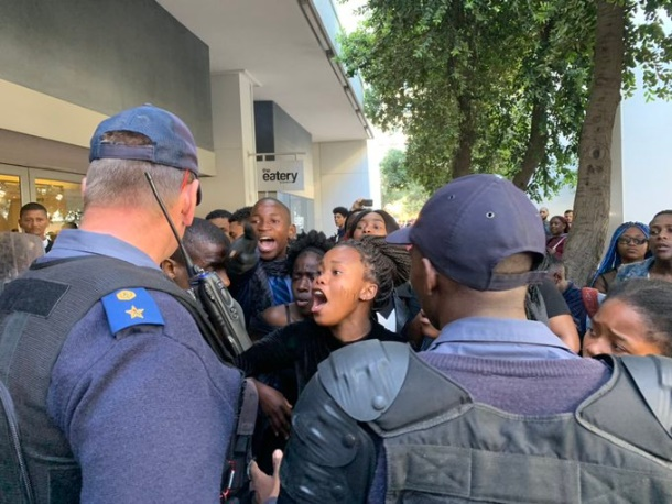 Police have just arrested someone, protesters demanding they release him. (News24)